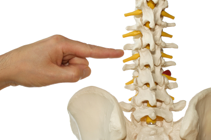 Hand pointing at spine
